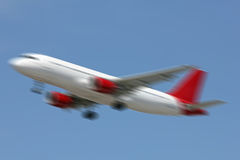 White and red plane landing Royalty Free Stock Photos