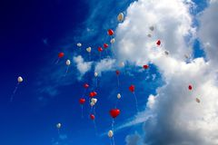 White and Red Plastic Heart Balloon on Sky during Daytime Stock Photo