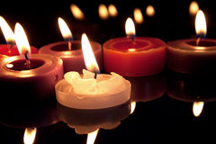 White, red and purple candles Stock Photography