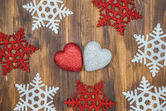 White and red shiny snowflakes and heart shape decoration on woo Stock Image