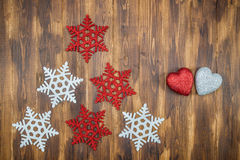 White and red shiny snowflakes and heart shape decoration on woo Royalty Free Stock Image