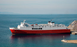 White-red ship in the port of Greece Royalty Free Stock Image