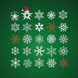 White and red snowflakes on dark green background Royalty Free Stock Photos