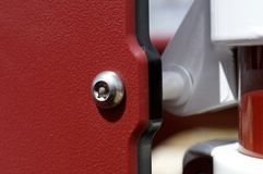 White and Red Structure. Stainless bolt hardware connecting white and red steel structure Stock Photo