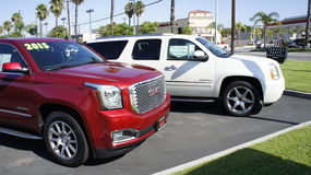 White and Red SUV. This red and white SUV displayed at the ground are for selling including other used and new and brand new cars Stock Images