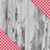 White and red tablecloth textile on wooden table. White and red tablecloth textile texture on wooden table background Royalty Free Stock Photo