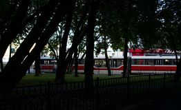 White and red tramway through the trees stock photos
