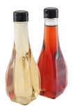 White and red vinegar. Bottles of white and red vinegar, isolated on white background Stock Images