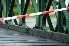 White and red warning line on the bridge. White and red warning line on the old bridge Royalty Free Stock Photo
