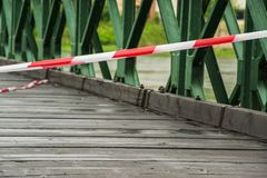 White and red warning line on the bridge. White and red warning line on the old bridge Stock Photography