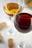 White and red wine. Glasses white and red wine on a white background Stock Images
