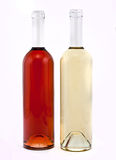 White and red wine bottles Royalty Free Stock Images