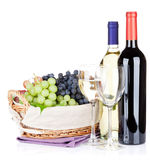 White and red wine bottles and grapes Royalty Free Stock Images