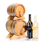 White and red wine in front of stacked barrels Royalty Free Stock Image