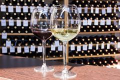 White and red wine in glasses stock photography