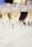 White and red wine glasses on blurred background. With shallow depth of field royalty free stock photos