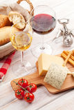 White and red wine glasses, cheese and bread Royalty Free Stock Photography