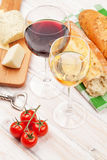 White and red wine glasses, cheese and bread Royalty Free Stock Image