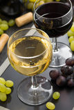 White and red wine in glasses closeup Stock Photos