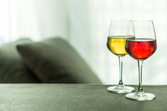 White & red wine in a living room Royalty Free Stock Photos