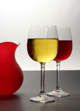 White and red wine with vase. White and red wine with red vase on bi-colored background Royalty Free Stock Image