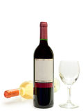 White and red wine with wineglass. Bottles of the white and red wine with wineglass against the white background royalty free stock photo