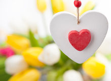 White and red wooden heart and tulips Royalty Free Stock Photo