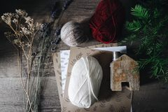 White Red Yarn and Papers on Table Royalty Free Stock Photo