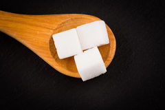 White refined sugar in wooden spoon Stock Images