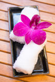 White refreshing towel with Thai orchid Royalty Free Stock Photography