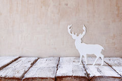 White reindeer on wooden table .selective focus Royalty Free Stock Images