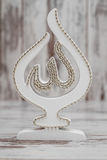 White Religious Statuette with the Name of Allah. The God written on it Royalty Free Stock Image