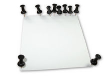 White reminder paper with many black push pins iso Royalty Free Stock Images