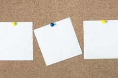 White reminder sticky note on cork board, empty space for text Royalty Free Stock Photo