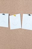White reminder sticky smile note on cork board Royalty Free Stock Photo