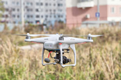 White remote controlled drone in flight Stock Images