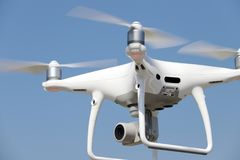White remote controlled drone flying Royalty Free Stock Photos