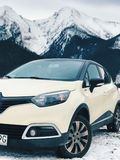 White Renault Clio 4 on Snow Covered Road Stock Photography