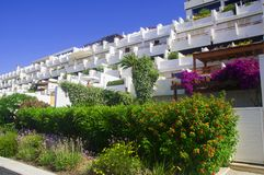 White resort houses with beautiful garden and flowers royalty free stock images