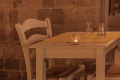 White restaurant table with candle outside on terrace Royalty Free Stock Photos