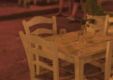 White restaurant table for four with candle outside on terrace Stock Photo