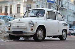 White retro car. Retro car on the winter street Stock Image