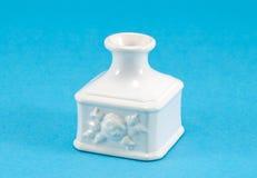 White retro ceramic vase dish blue background Royalty Free Stock Photos