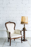 White Retro Chair with Lamp Royalty Free Stock Photography