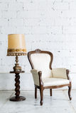 White Retro Chair with Lamp Royalty Free Stock Image