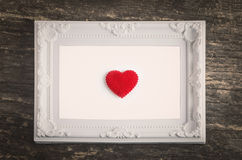 White retro frame with red heart Royalty Free Stock Photo
