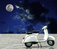 White retro motorbike with full moon in night sky. Stock Image