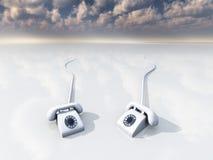 White retro phones in surreal space Stock Image
