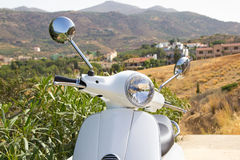 White retro scooter in mountains of Greece Stock Image