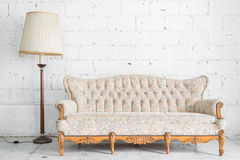 White Retro Sofa with lamp Royalty Free Stock Images